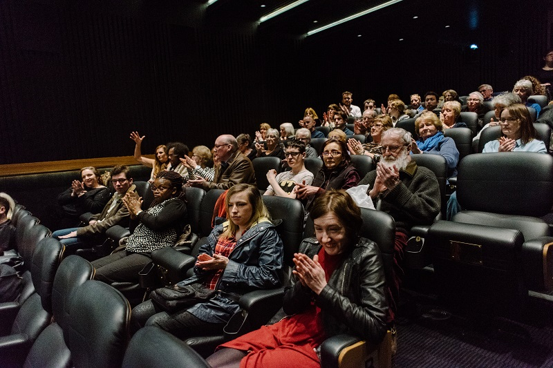 Photo of visible cinema audience.