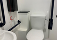 Accessible toilet with full length cord