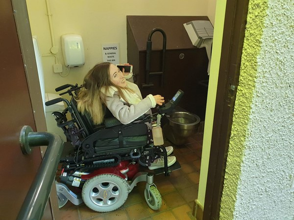 Image of disabled toilet showing size compared to wheelchair size.