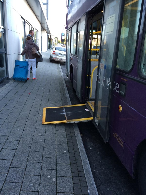 Bus with wheelchair ramp.