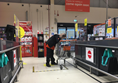 Image of the till area of the B&Q store showing staff member scanning my items.