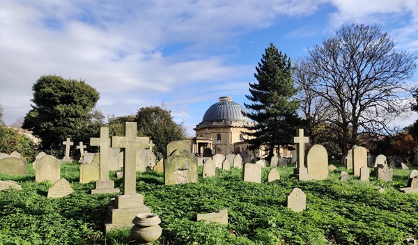 A view of the domed chapel across the gravestones of the cemetery.