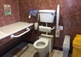 The accessible toilet with changing bench.