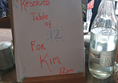 Board saying Reserved for party of 12 for Kim.