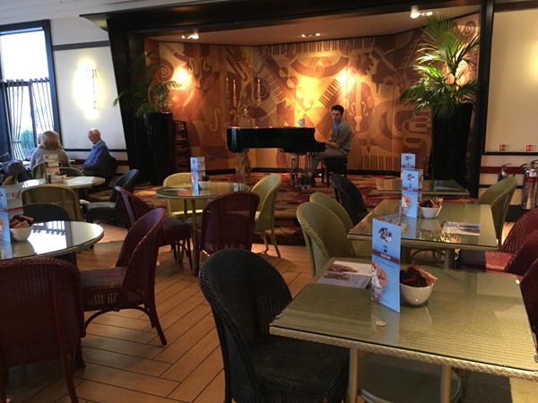 Piano player and interior of restaurant