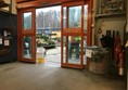 Image of the automatic door leading out into the garden centre showing the sign in the way.