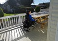Wheelchair accessible picnic table on caravan decking.
